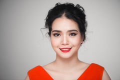 Fashion portrait of asian woman with elegant hairstyle. Perfect. Makeup royalty free stock image