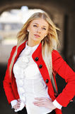 Fashion portrait of attractive young woman in red jacket Stock Photos