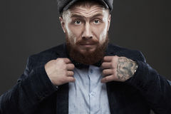 Fashion Portrait of bearded man in suit.old Hipster boy.handsome man in hat.Brutal Royalty Free Stock Images