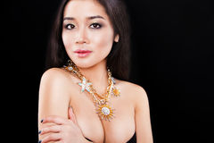 Fashion portrait of a beautiful asian model with. Portrait of a beautiful brunette girl with luxury accessories.Beauty with jewellery. happy fashion model Stock Photo