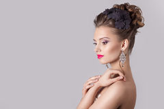 Fashion portrait of a beautiful attractive girl with a gentle elegant evening wedding hairstyles high and bright make-up Royalty Free Stock Photos
