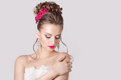 Fashion portrait of a beautiful attractive girl with a gentle elegant evening wedding hairstyles high and bright make-up with flow stock image