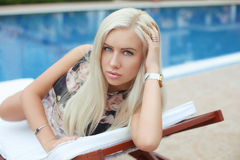Fashion portrait of beautiful blond girl model resting on beach Royalty Free Stock Photos
