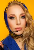 Fashion portrait of a beautiful blonde in a blue kerchief and a Stock Image