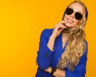 Fashion portrait of a beautiful blonde in a blue scarf and jacke Royalty Free Stock Image