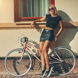 Fashion portrait of beautiful blonde girl near vintage bicycle Stock Images