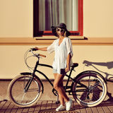 Fashion portrait of beautiful blonde on a vintage bicycle Stock Photography