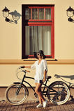Fashion portrait of beautiful blonde on a vintage bicycle Royalty Free Stock Photos