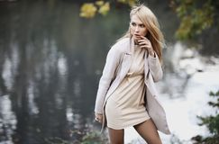Fashion portrait of beautiful blonde woman in stylish clothes outdoor in autumn. Fashion portrait of beautiful blonde woman in stylish clothes outdoor in autumn Stock Images