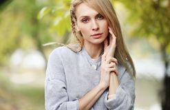 Fashion portrait of beautiful blonde woman in stylish clothes outdoor in autumn. Fashion portrait of beautiful blonde woman in stylish clothes outdoor in autumn Royalty Free Stock Images