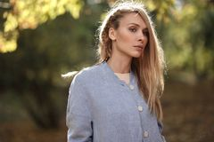 Fashion portrait of beautiful blonde woman in stylish clothes outdoor in autumn. Fashion portrait of beautiful blonde woman in stylish clothes outdoor in autumn Stock Photos