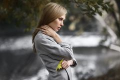 Fashion portrait of beautiful blonde woman in stylish clothes outdoor in autumn. Fashion portrait of beautiful blonde woman in stylish clothes outdoor in autumn Stock Photo