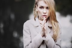 Fashion portrait of beautiful blonde woman in stylish clothes outdoor in autumn. Fashion portrait of beautiful blonde woman in stylish clothes outdoor in autumn Royalty Free Stock Image