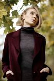Fashion portrait of beautiful blonde woman in stylish clothes outdoor in autumn. Fashion portrait of beautiful blonde woman in stylish clothes outdoor in autumn Stock Photography