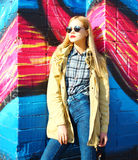Fashion portrait beautiful blonde young woman in city. Fashion portrait beautiful blonde young woman posing in city Royalty Free Stock Photo