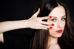 Portrait of beautiful brunette with red nails Stock Photo