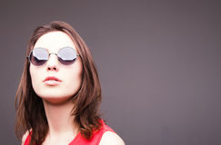 Fashion portrait of a beautiful brunette woman in glasses Royalty Free Stock Photography