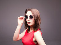 Fashion portrait of a beautiful brunette woman in glasses Royalty Free Stock Photo