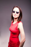 Fashion portrait of a beautiful brunette woman in glasses Stock Image