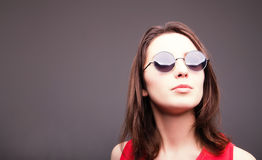 Fashion portrait of a beautiful brunette woman in glasses Royalty Free Stock Image