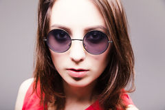 Fashion portrait of a beautiful brunette woman in glasses stock photography