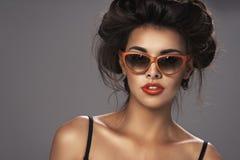 Fashion portrait of a beautiful brunette woman Stock Photo