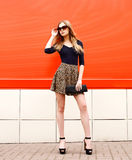 Fashion portrait of beautiful elegant young woman in leopard Royalty Free Stock Photos