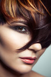 Fashion portrait of a beautiful girl with colored dyed hair, professional short hair coloring. royalty free stock image