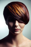 Fashion portrait of a beautiful girl with colored dyed hair, professional short hair coloring. stock photos
