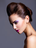 Fashion portrait of a beautiful  girl with creative hairstyle an Stock Image