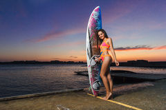 Fashion portrait: beautiful girl with surf board enjoing herself Stock Image