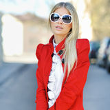 Fashion portrait of a beautiful girl wearing sunglasses Stock Photography