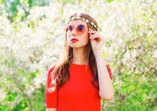 Fashion portrait beautiful hippie woman over flowering garden. Background Royalty Free Stock Photos