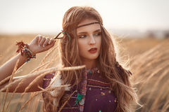Fashion portrait of beautiful hippie woman at the sunset summer Royalty Free Stock Photo