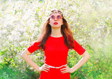 Fashion portrait beautiful hippie young woman over flowering. Garden background Royalty Free Stock Images