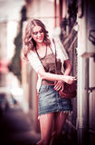 Fashion  portrait of beautiful model on the street Stock Images