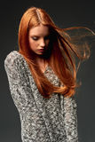 Fashion portrait of beautiful red haired girl with flying hair stock photo