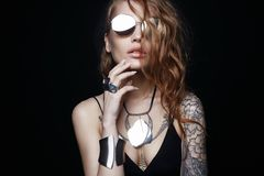 Beauty tattooed girl in sunglasses and jewelry stock images