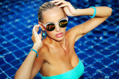 Fashion portrait of beautiful tanned woman with blond hair in el Royalty Free Stock Photography