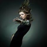 Fashion portrait of the beautiful woman Stock Photos