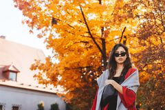 Fashion portrait of beautiful woman in autumn park. Fashion portrait of beautiful woman in stylish clothes in autumn park stock image