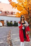 Fashion portrait of beautiful woman in autumn park. Fashion portrait of beautiful woman in stylish clothes in autumn park stock photo