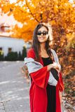 Fashion portrait of beautiful woman in autumn park. Fashion portrait of beautiful woman in stylish clothes in aun park stock images