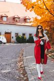 Fashion portrait of beautiful woman in autumn park. Fashion portrait of beautiful woman in stylish clothes in autumn park. The girl walks in the park stock images