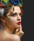 Fashion Portrait. Beautiful woman with colored hai Stock Image