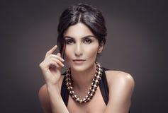 Fashion Portrait Of Beautiful Woman. Dark Background. Stock Image