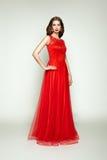 Fashion portrait of beautiful woman in elegant dress Stock Photography