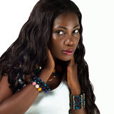 Beautiful African young Woman Face. Portrait of a beautiful African woman with beaded bangles royalty free stock photos
