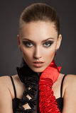 Fashion Portrait of a beautiful woman in gloves Royalty Free Stock Image