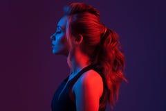 Fashion portrait of beautiful woman. Hairstyle. Blue and red li stock photo